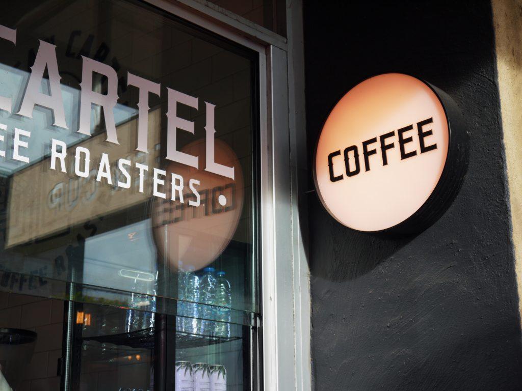 The Bean Cartel Origin Coffee Roasters cafe logo sign