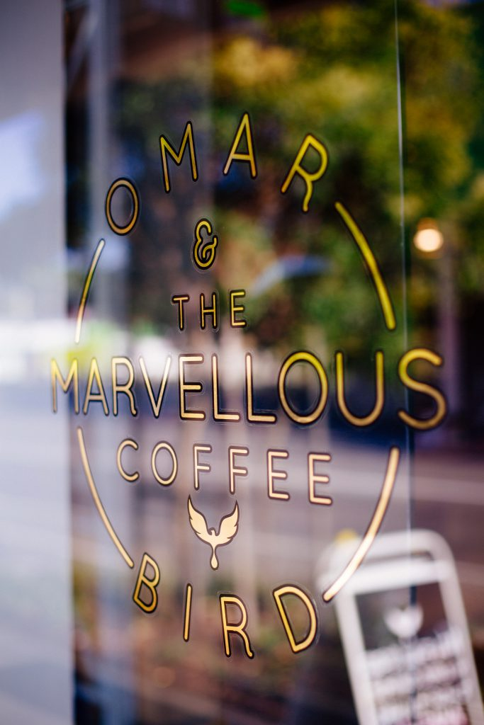 Omar Coffee Bird door signage